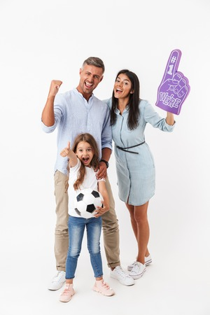Excited family watching football together and cheering isolated over white