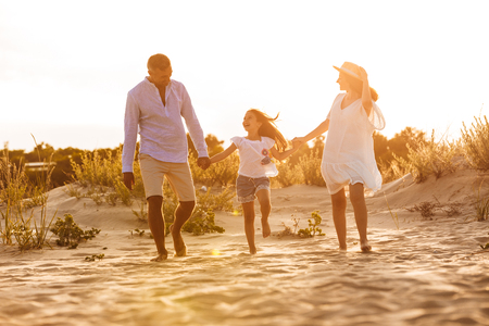 Picture of young happy family having fun together at the beach.
