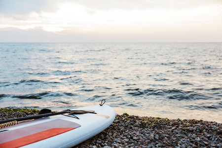 Image of the kayak on the beach near sea water