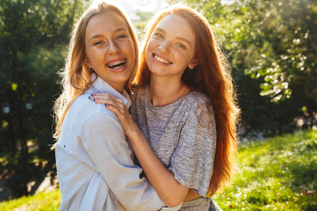 Two happy youg girls having fun at the park Stock Photo