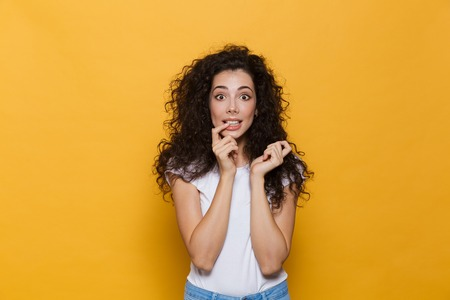 Image of amazing excited young cute woman posing isolated over yellow background.