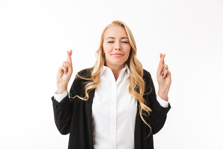 Image of amazing business woman posing isolated over white background wall make hopeful gesture. Stok Fotoğraf