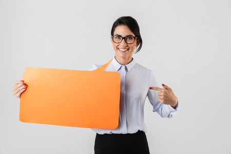 Image of adorable office woman wearing eyeglasses holding yellow copyspace placard isolated over white background Banque d'images - 117378684