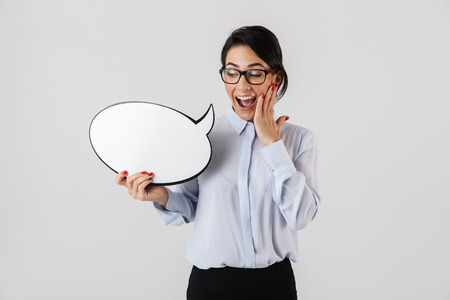 Photo of modern female worker wearing eyeglasses holding blank thought bubble isolated over white background Banque d'images - 117378692