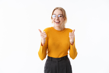 Attractive young blonde woman wearing sweater standing isolated over white background, thumbs up