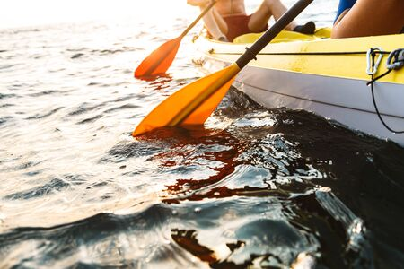 Cropped image of a sporty attractive couple kayaking on sea together