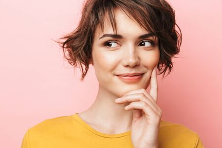 Image of young happy beautiful woman posing isolated over pink wall background.