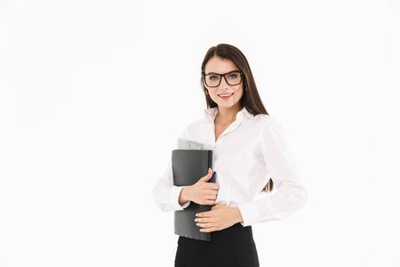 Photo of cheerful female worker businesswoman dressed in formal wear holding bookbinder with documents while working in office