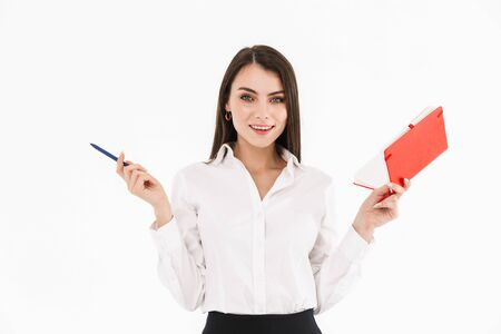 Photo of attractive female worker businesswoman dressed in formal wear holding day planner while working in office