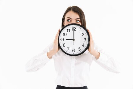 Photo of happy female worker businesswoman dressed in formal wear holding big wall clock while working in office