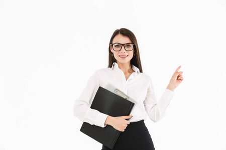 Photo of charming female worker businesswoman dressed in formal wear holding bookbinder with documents while working in office