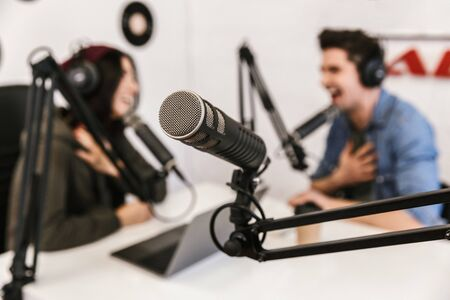 Two radio hosts moderating a live show for radio Stock Photo