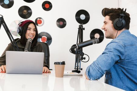 Two radio hosts moderating a live show for radio Stok Fotoğraf
