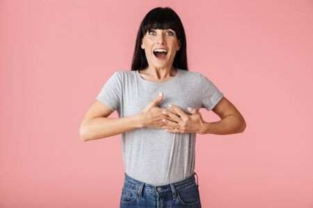 Image of a beautiful amazing happy excited woman posing isolated over light pink background wall. Stock Photo