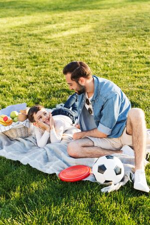 Two happy brothers spending fun time at the park, having a picnic on grass 写真素材 - 128693137
