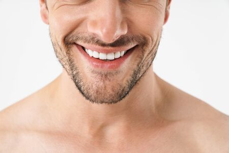 Cropped photo closeup of attractive naked man smiling at camera with white teeth isolated over white background