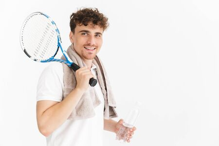 Photo closeup of caucasian man with towel holding racquet and water bottle while playing tennis isolated over white background