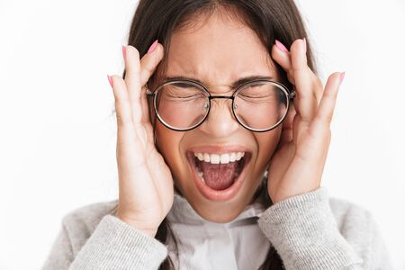Photo closeup of shocked frightened girl wearing eyeglasses screaming and covering her face isolated over white background