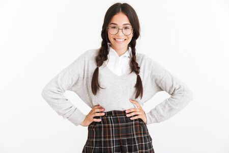 Photo closeup of caucasian teenage girl wearing eyeglasses and school uniform smiling at camera isolated over white background Stock Photo