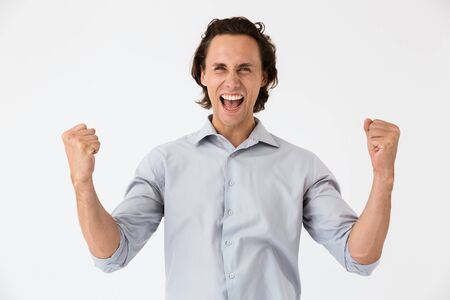 Image closeup of successful businessman in office shirt screaming and rejoicing isolated over white background Stock Photo
