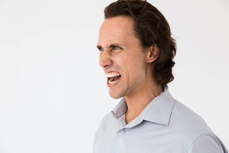 Image of annoyed businessman in office shirt screaming in anger isolated over white background Stock Photo