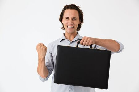 Image closeup of caucasian businessman in office shirt screaming and holding black briefcase isolated over white background Stock Photo