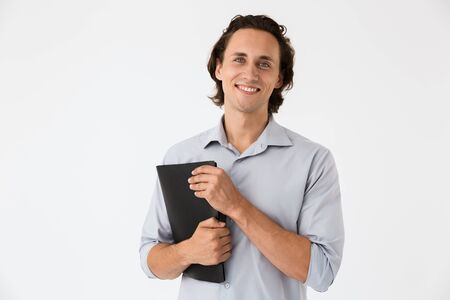 Image closeup of happy businessman in office shirt smiling and holding documents folder isolated over white background