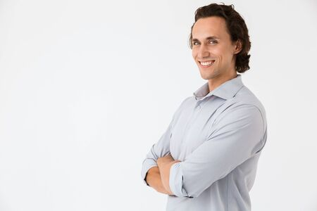 Image of pleased businessman in office shirt smiling and looking at camera isolated over white background Stock Photo
