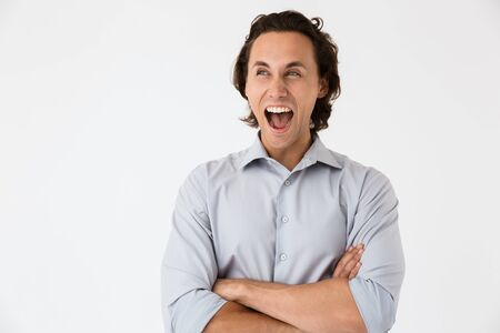 Image closeup of delighted businessman in office shirt screaming at camera isolated over white background