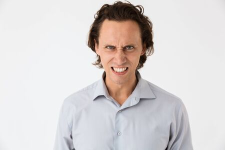 Image of confused businessman in office shirt screaming in anger isolated over white background