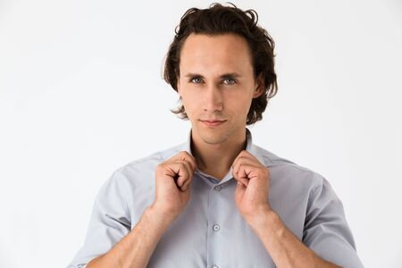 Image closeup of confident businessman in office shirt looking at camera isolated over white background