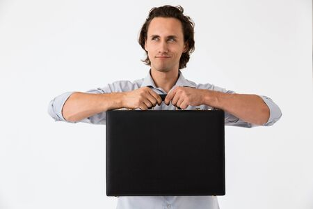 Image closeup of successful businessman in office shirt smiling and holding black briefcase isolated over white background