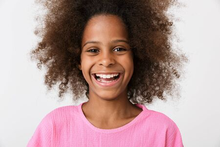 Image of a happy laughing young african girl kid posing isolated over white wall background.