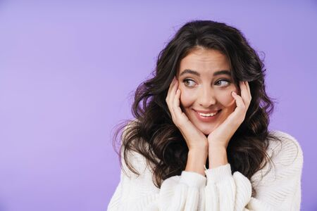 Image of cheerful happy young brunette woman posing isolated over purple wall background looking aside. 版權商用圖片