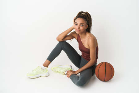 Young african american woman basketball player isolated over white background