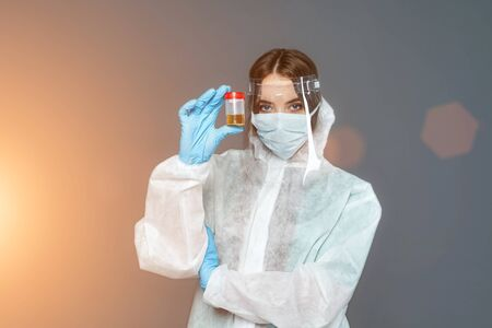 female doctor in protective suit and gloves