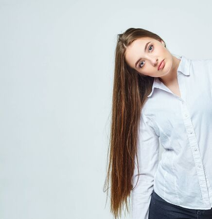 beautiful girl with very long hair on a white background