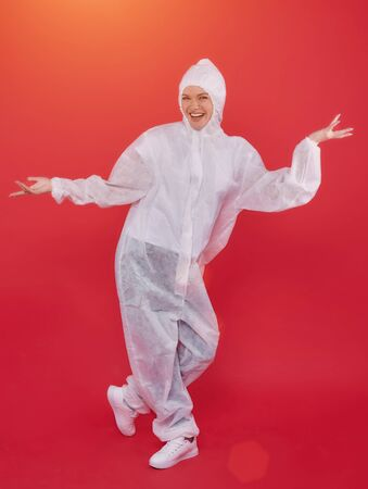 female doctor in a chemical suit. concept of medicine. red background