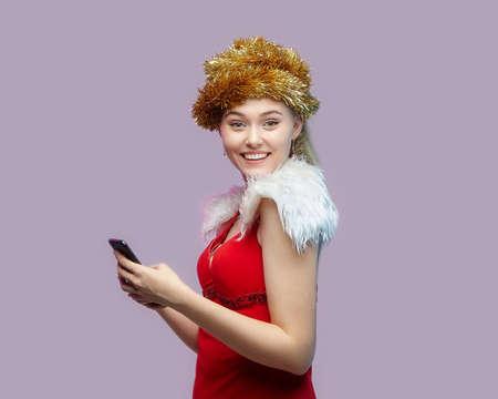 beautiful young woman in Santa costume holding Christmas ornaments 版權商用圖片