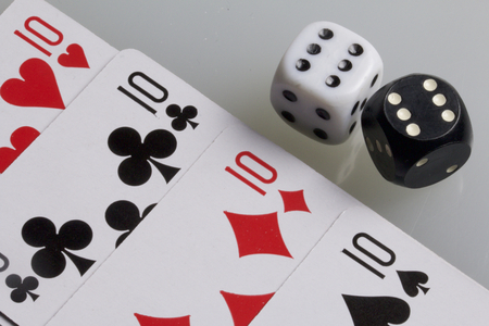 scores: Cards and dice. Accessories for the game. Four scores. Dice white and black. On a white background. Stock Photo