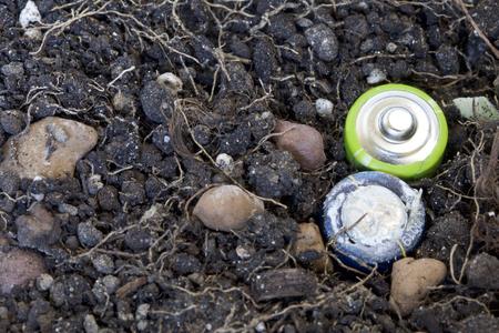 hazardous waste: Spoil the batteries are in the ground. Processing hazardous waste. Environmental protection. Stock Photo