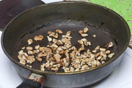 craked: Toast the walnuts in a frying pan. For cooking chicken with carrots and walnuts.