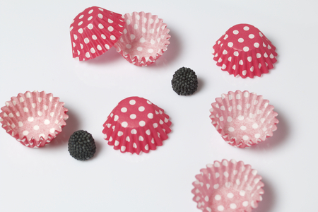 Decoration for baking in the form of raspberries. It is worth it among the molds for baking cakes. On a white background.