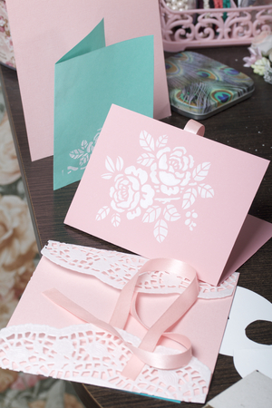 Making greeting cards from paper, cardboard and tape.