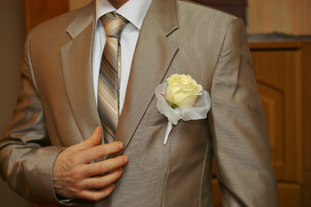 Boutonniere on the grooms wedding suit.