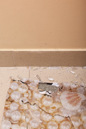 Broken bathroom scales. Toughened glass crumbled into pieces from a blow.