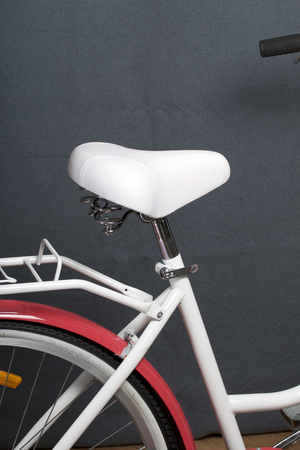 Elements of a female bicycle in white and pink color.  Trunk, seat and wheel. Spring and summer recreation and sports. 版權商用圖片