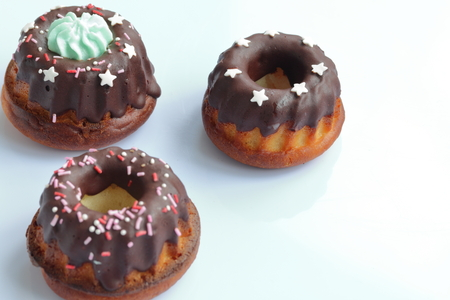 Chocolate coated cakes with decorative topping. Located in the shape of a triangle.
