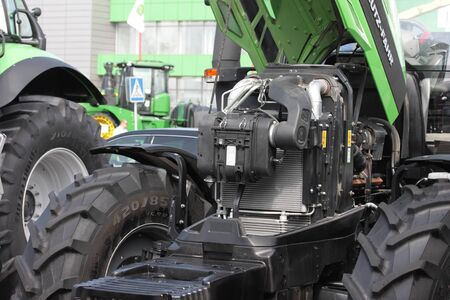 MINSK, MINSK, BELARUS 6 JUNE 2019, Exposition at the exhibition BELAGRO 2019. Energy-efficient tractor close-up. With a raised hood.