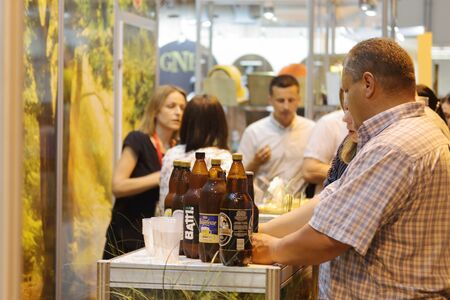 MINSK, MINSK, BELARUS 6 JUNE 2019, Exposition at the exhibition BELAGRO 2019. Food industry products. Visitors view alcohol and beer.